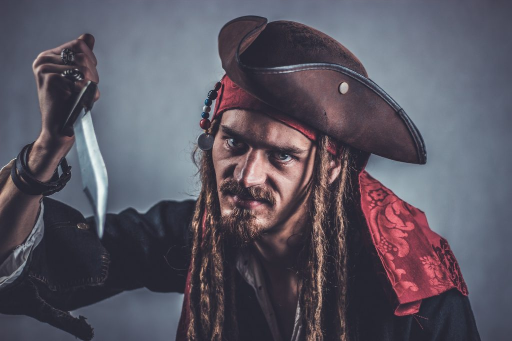 A pirate holding a knife and wondering if he needs new knives
