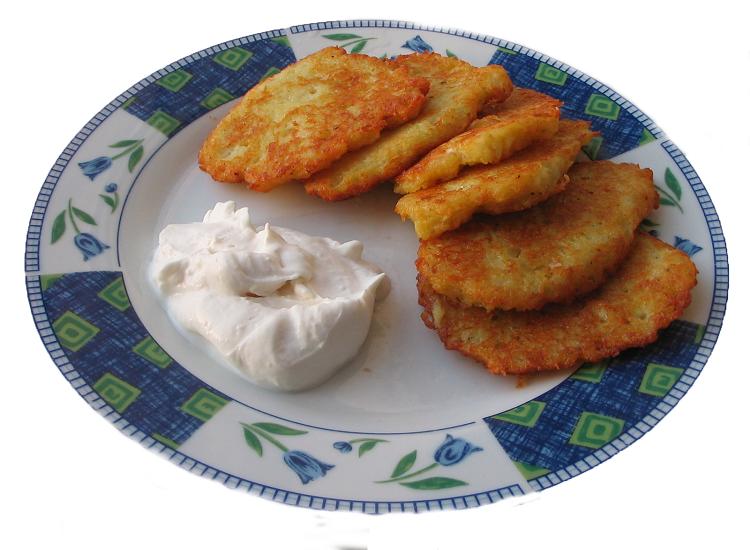 potato latkes with white sauce on a plate