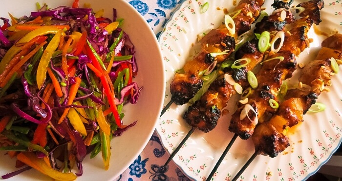 chicken satay skewers and salad