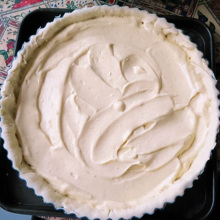 putting custard in pastry form